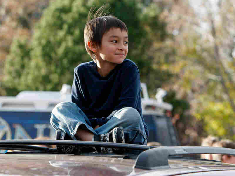 Six-year-old Falcon Heene sits on the roof of his family's van