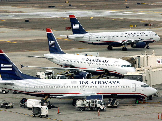 US Airways planes prepare to taxi for takeoff at Sky Harbor Airport in Phoenix in 2007. US Airways is one of many airlines that have farmed out some maintenance to repair shops in developing countries.