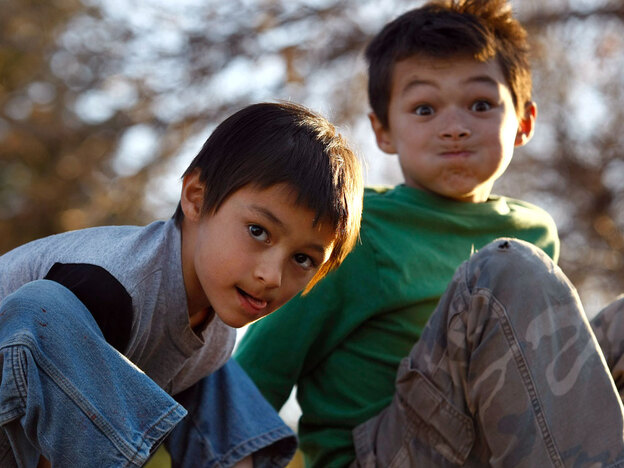 Falcon Heene (left), 6, and his brother Ryo, 8, are shown outside their home in Fort Collins, Colo., on Thursday after Falcon was found hiding in the attic.