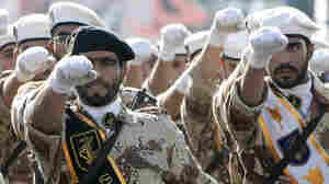 Iran's elite Revolutionary Guards march during a military parade in Tehran in 2008