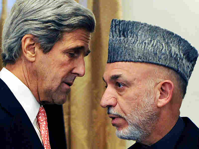 U.S. Sen. John Kerry speaks with Afghan President Karzai