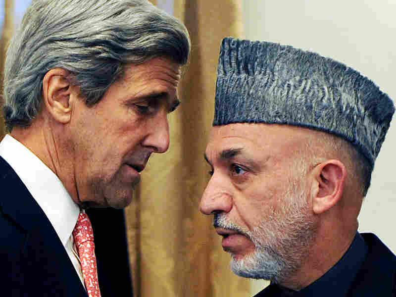 U.S. Sen. John Kerry speaks with Afghan President Karzai