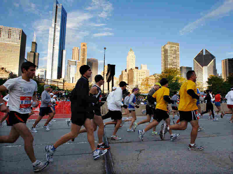 Runners take off from the starting point of the Chicago Marathon on Oct. 11.
