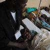 Minister with rape victim in Goma, Democratic Republic of Congo