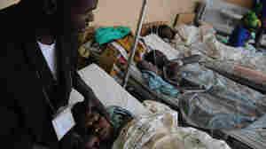 WIDE: Minister with rape victim in Goma, Democratic Republic of Congo