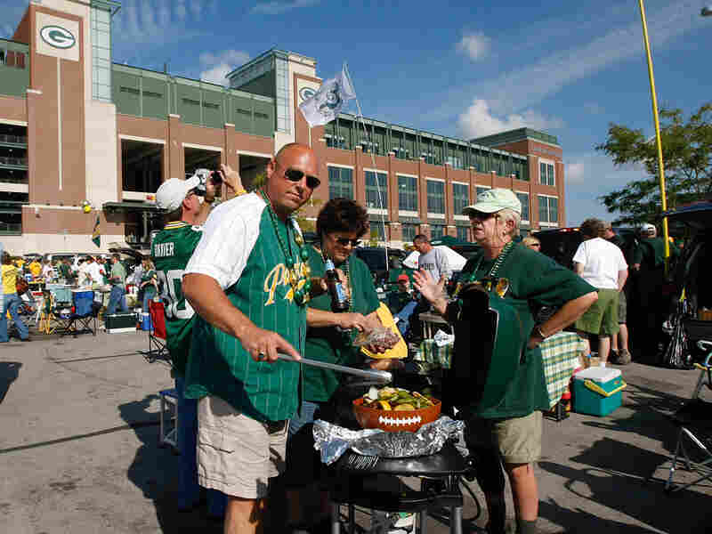 Green Bay Packers fans take advantage of a warm September to tailgate outside Lambeau Field.