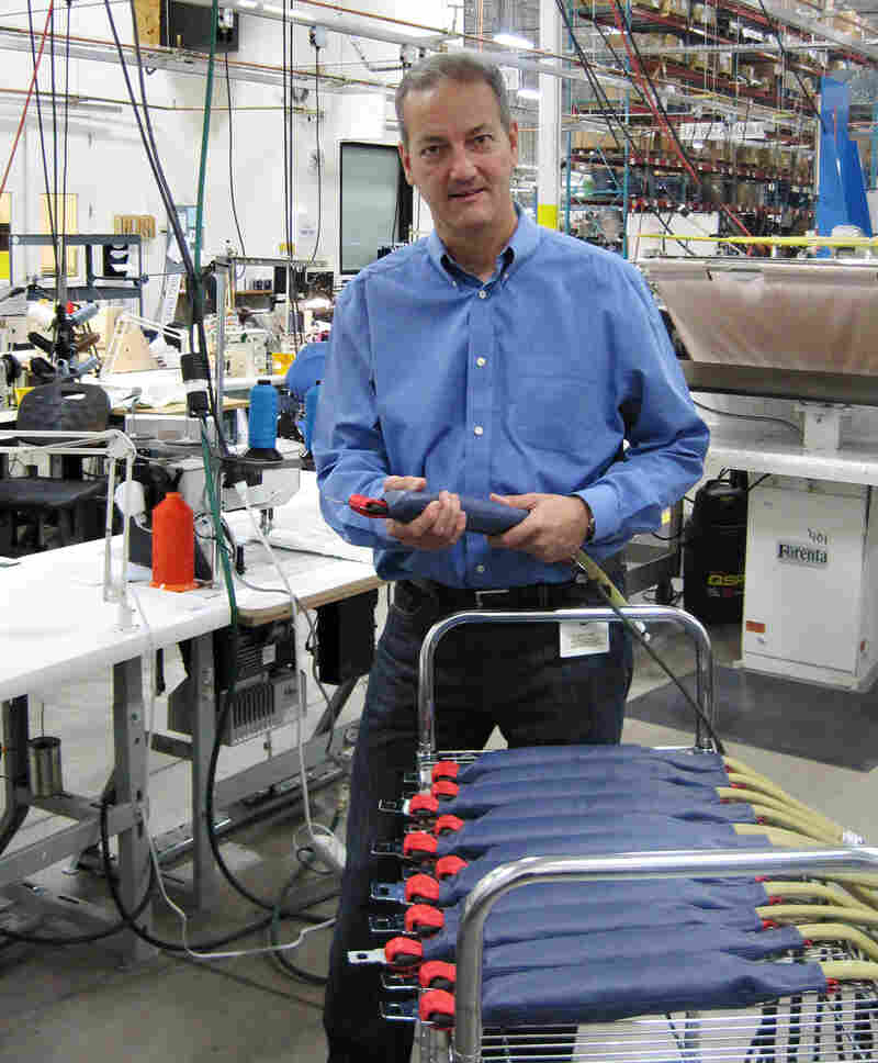 CUSTOM: AmSafe's Bill Hagan displays the seatbelts with air bags