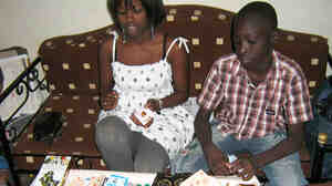 WIDE: Aby Ba, from left, and Ousmane Mactar Ba play the board game Jekaben