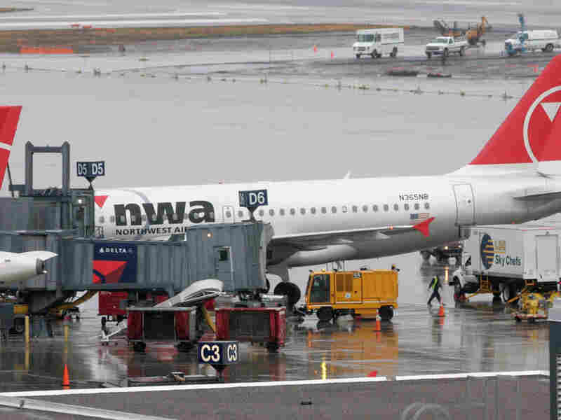 Personnel prepare a Northwest Airlines jet for a flight in Minneapolis.