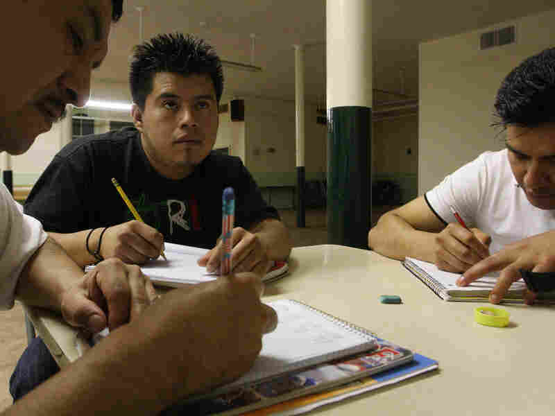 Mexicans now living in New York attend a math class.