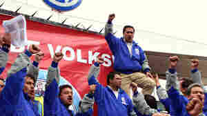 WIDE: Mexican workers shout slogans during a strike at Volkswagen's plant in Puebla, Mexico.