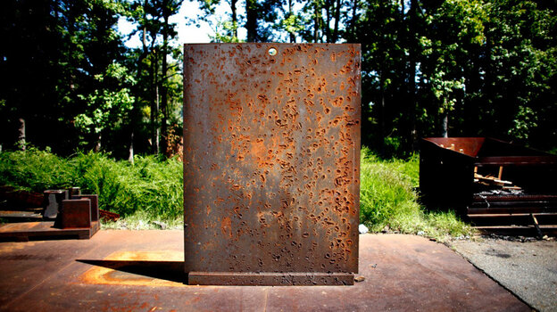 A scarred blast wall on the Aberdeen Proving Ground