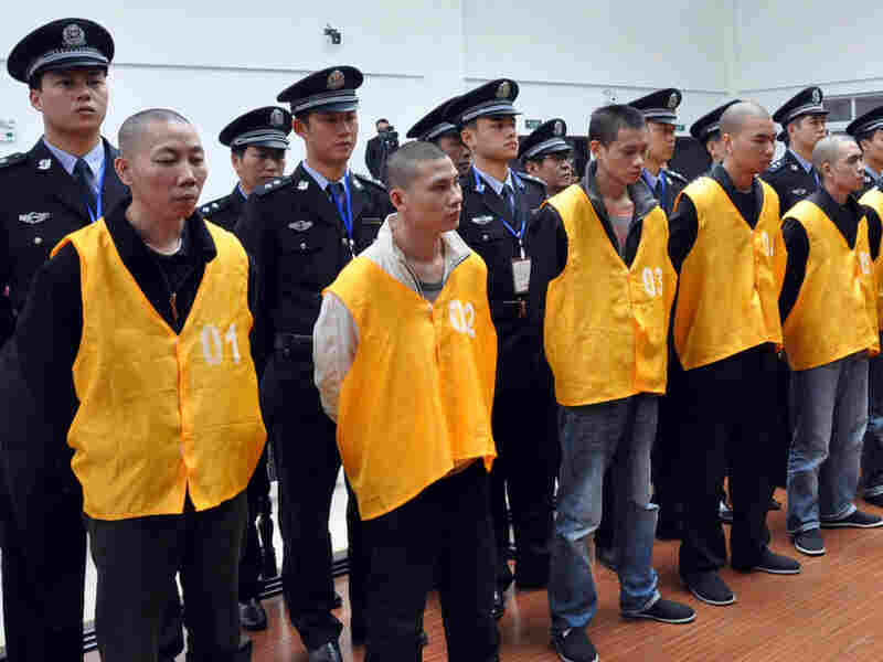 A group of defendants faces sentencing for organized crime in Chongqing