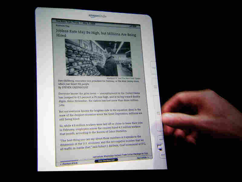 A Kindle DX, displaying a page from 'The New York Times'