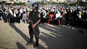 A member of Hamas movement's security forces stands guard during a religious gathering.