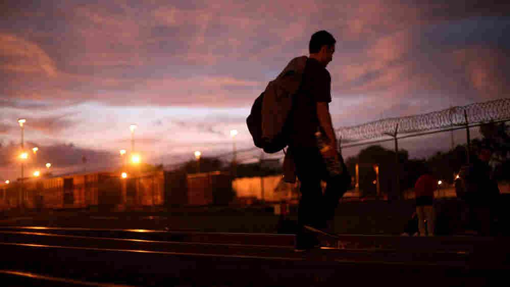 A migrant from Guatemala walks along train tracks in Guadalajara, Mexico