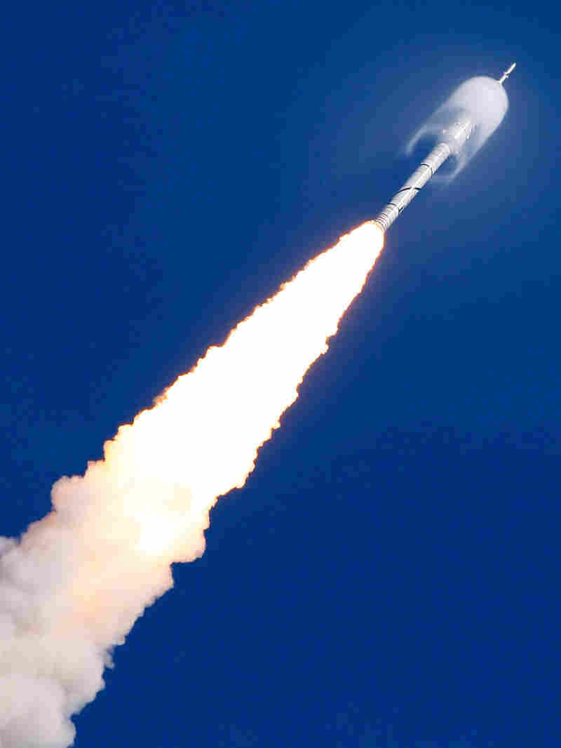 A cone of moisture surrounds the Ares I-Xrocket.