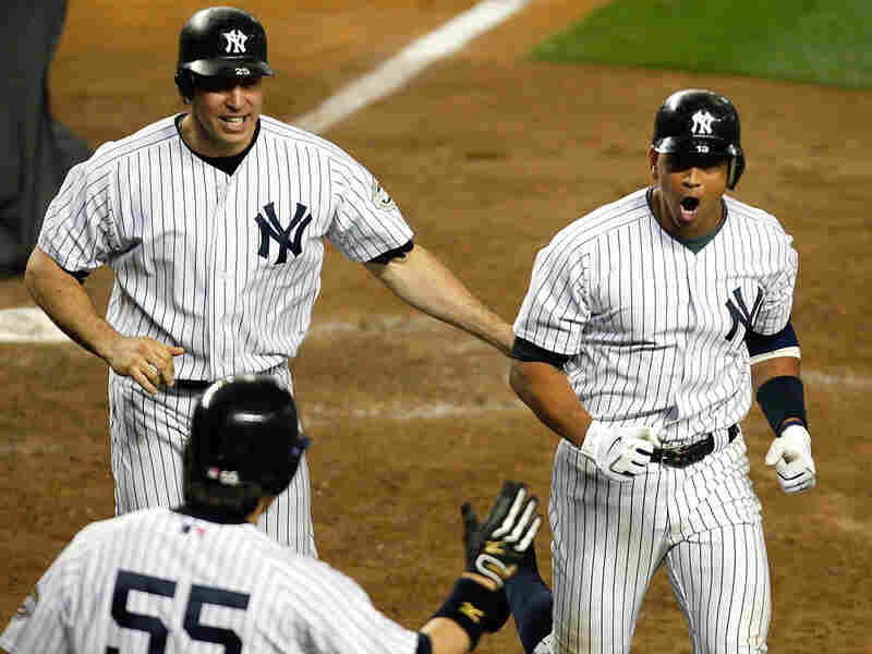 Alex Rodriguez (right) celebrates with Mark Teixeira (No. 25) after hitting a two-run homer.