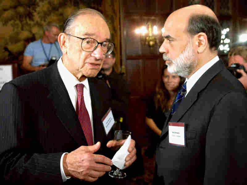 Federal Reserve Chairman Ben Bernanke, right, and former chairman Alan Greenspan, left,