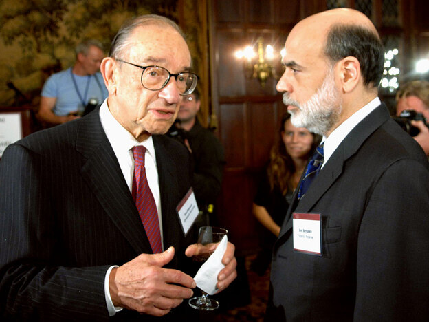 Federal Reserve Chairman Ben Bernanke (right) disagrees with former Chairman Alan Greenspan's position that the size of financial institutions should be limited.