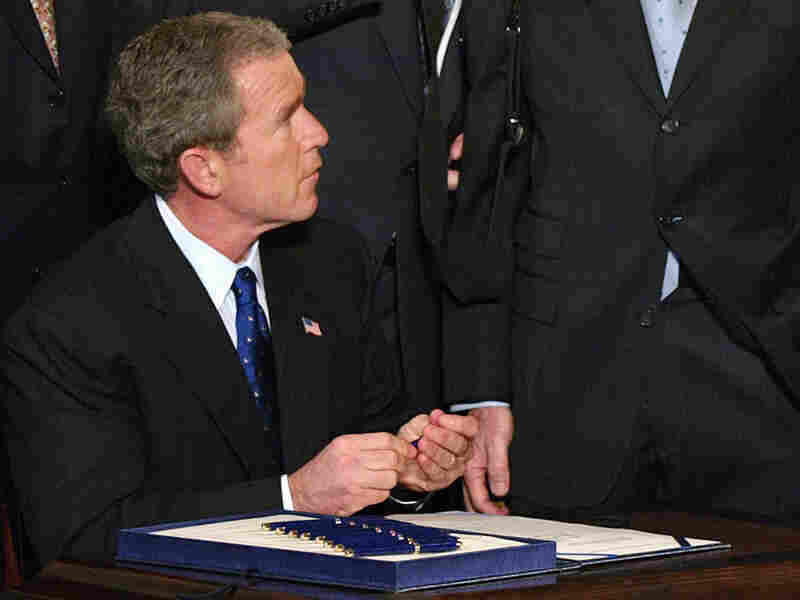 President Bush signs the Patriot Act into law.