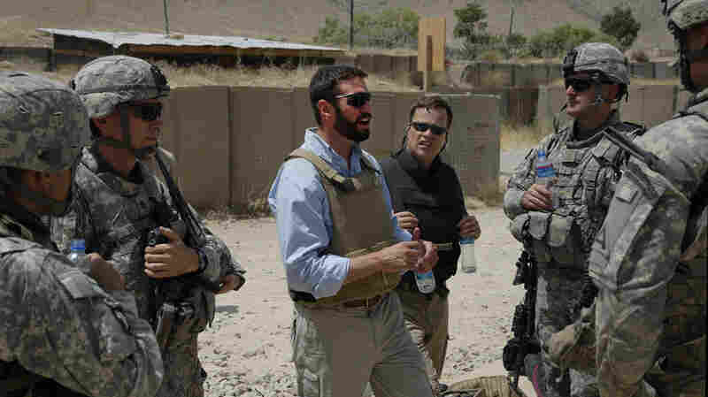 Matthew Hoh speaks with soldiers and airmen in Afghanistan.