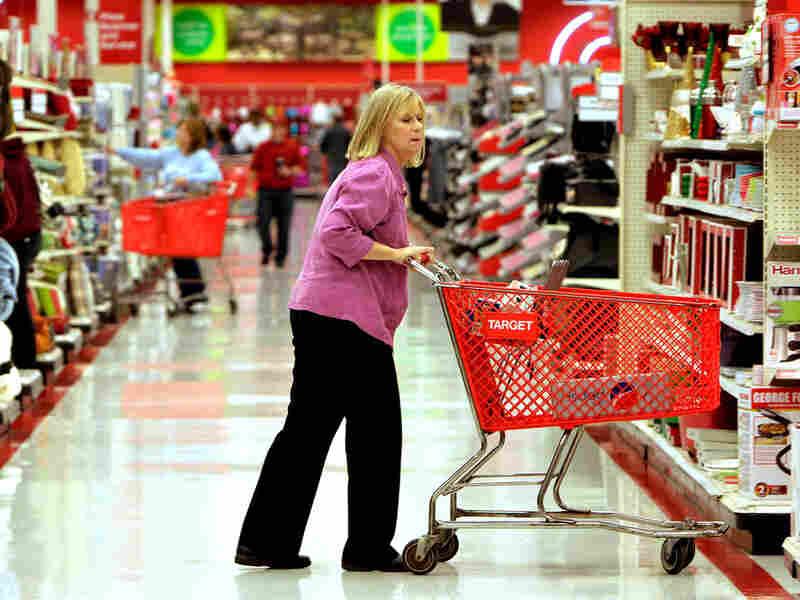 A shopper makes her way down an aisle