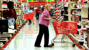 A shopper makes her way down an aisle