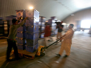 Workers transport ballot boxes in Afghanistan.