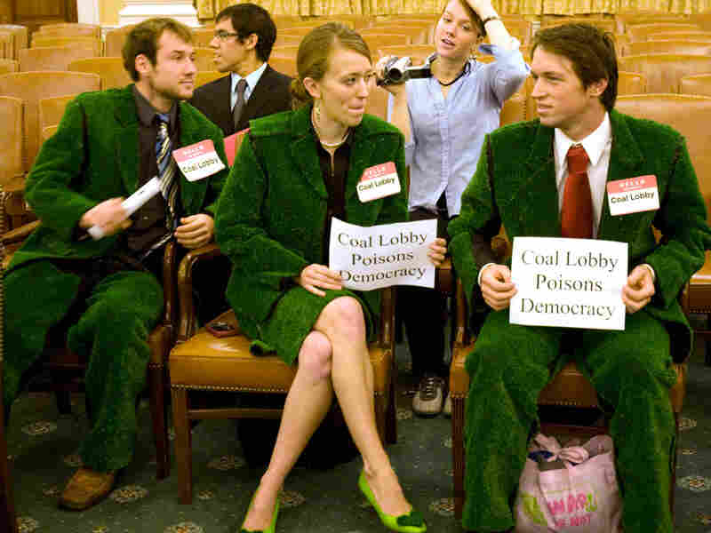 Members of the Climate Action Factory attend a House hearing
