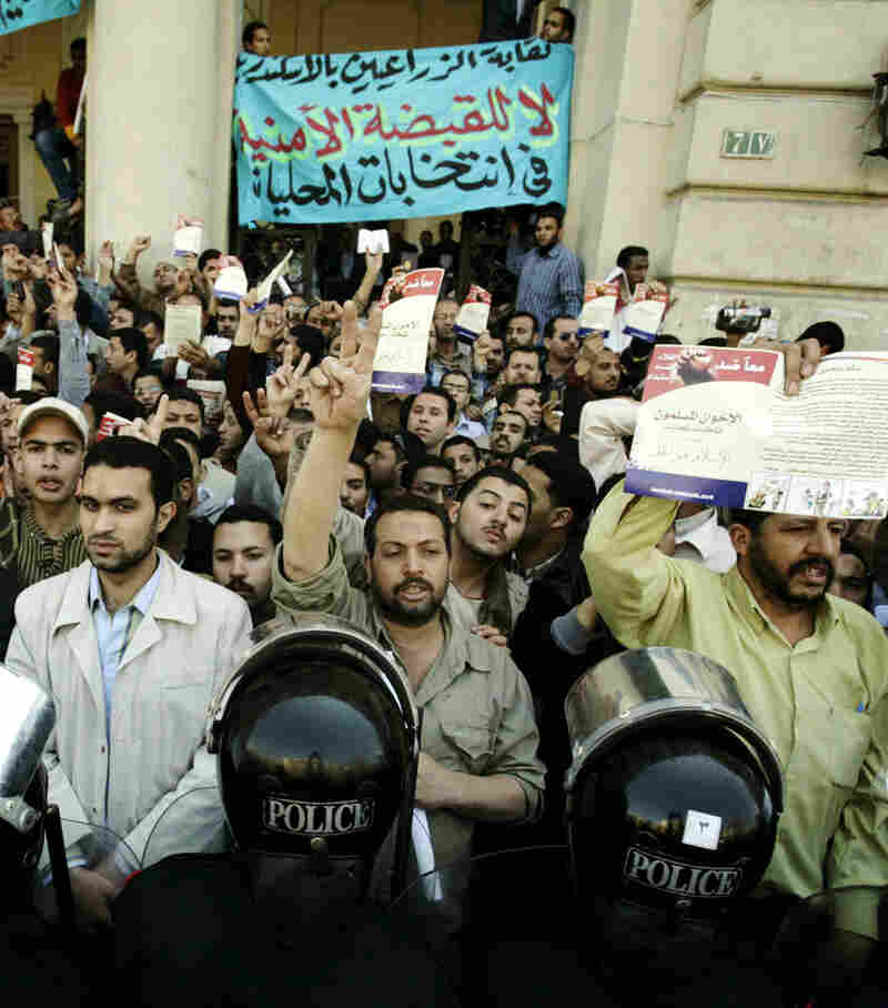 CUSTOM: Muslim Brotherhood supporters in Egypt protest the arrests of the group's leaders last year