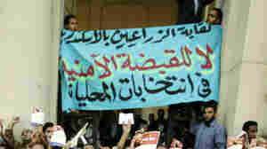 WIDE: Muslim Brotherhood supporters in Egypt protest the arrests of the group's leaders last year