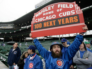 A Cubs fan holds up a sign. M. Spencer Green/AP