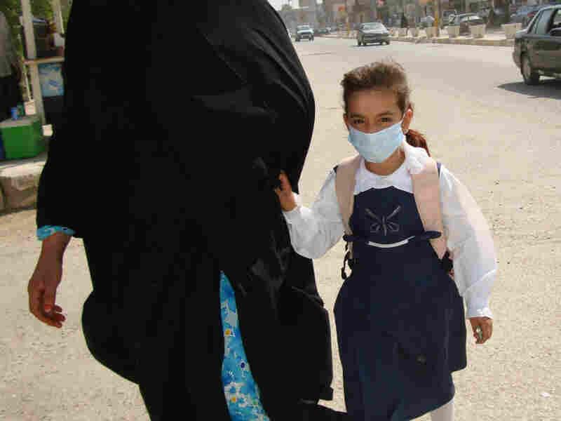 An Iraqi schoolgirl in the city of Kut