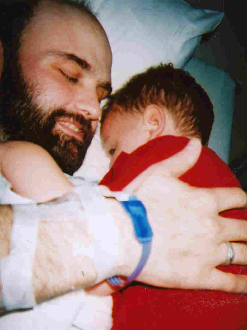 Fred Holliday holds his son Issac.