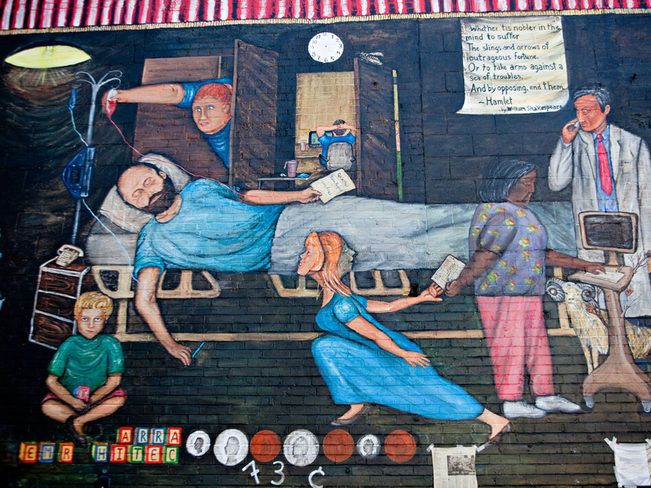A detail of Regina Holliday's mural showing her husband, Fred, in his hospital bed receiving a blood transfusion.