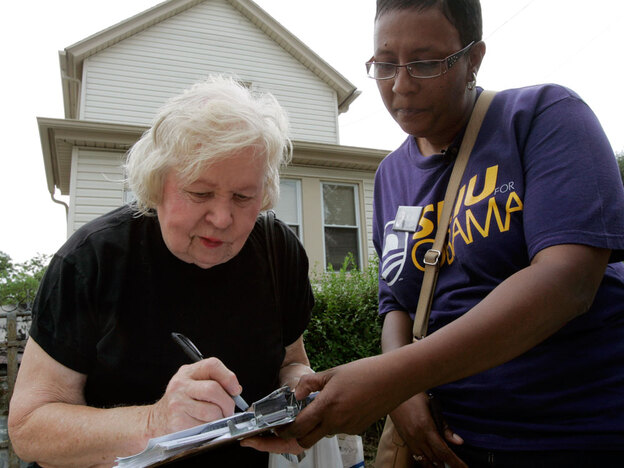 Linda Graham helped register voters like Florence Dziamniski in 2008. Here, Dziamniski fills out a voter registration form outside a senior citizens home in Clairton, Pa.