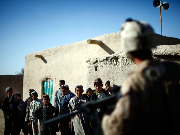 Marines talk with villagers while on patrol outside Patrol Base Hassan Abad in Helmand province.