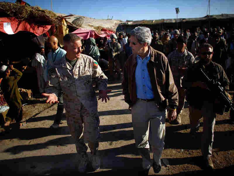 Sen. John Kerry (D-MA) walks through the Garmsir marketplace in Helmand province
