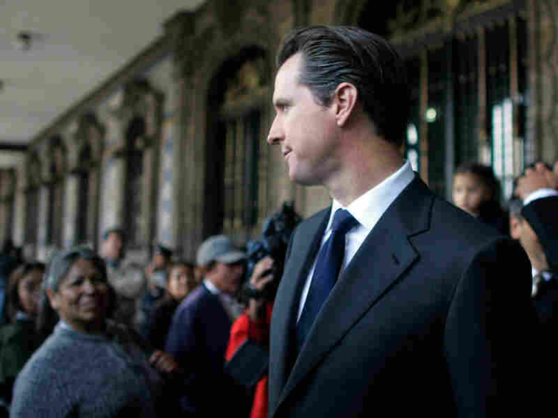 San Francisco Mayor Gavin Newsom walks at the main Zocalo square in Mexico City
