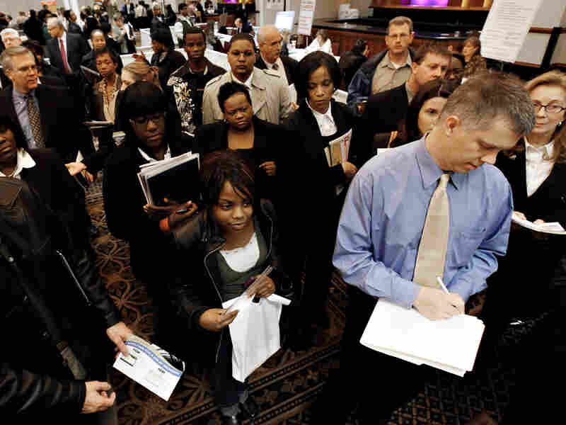 Job-seekers attend a job fair in Livonia, Mich., on Wednesday.