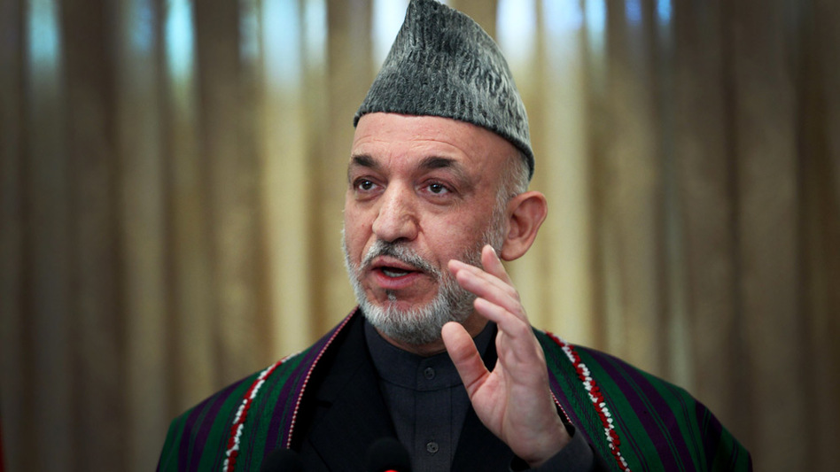Afghan President Hamid Karzai speaks during a Tuesday news conference at the Presidential Palace in Kabul.