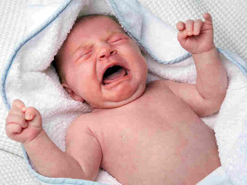 A newborn baby cries.