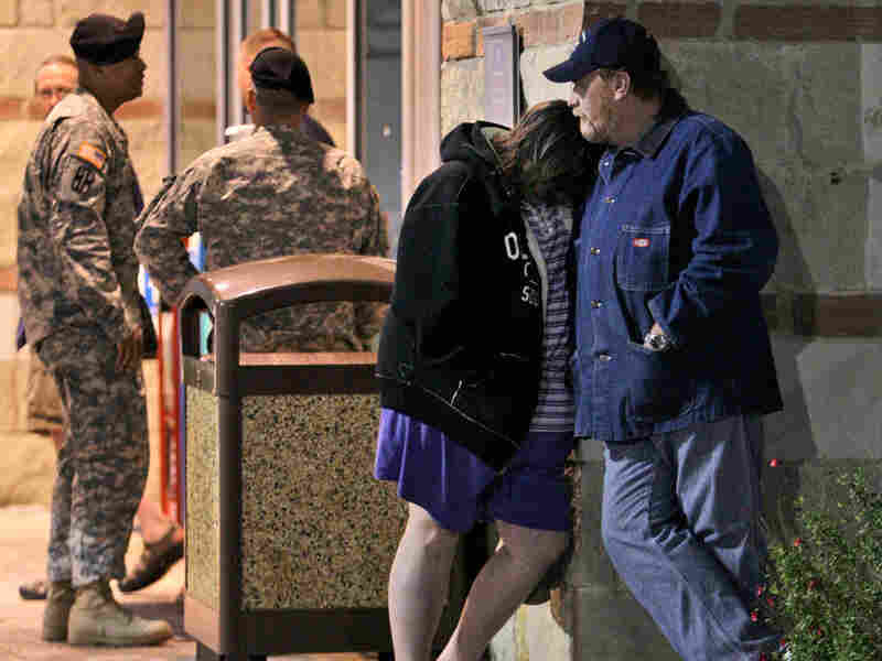 Jamie Casteel and her husband, Scotty, await news of their son-in-law outside the emergency room