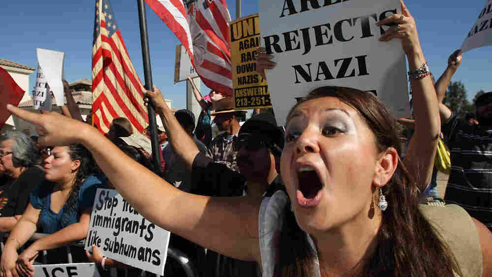 Erika Paz yells at members of the National Socialist Movement at a rally.