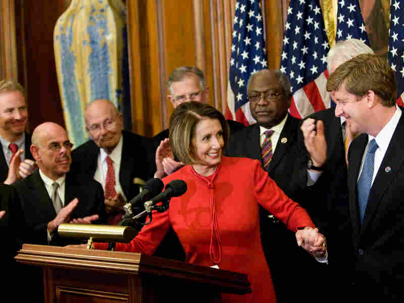 House Speaker Nancy Pelosi takes the hand of Rep. Patrick Kennedy. Brendan Smialowski/Getty Images