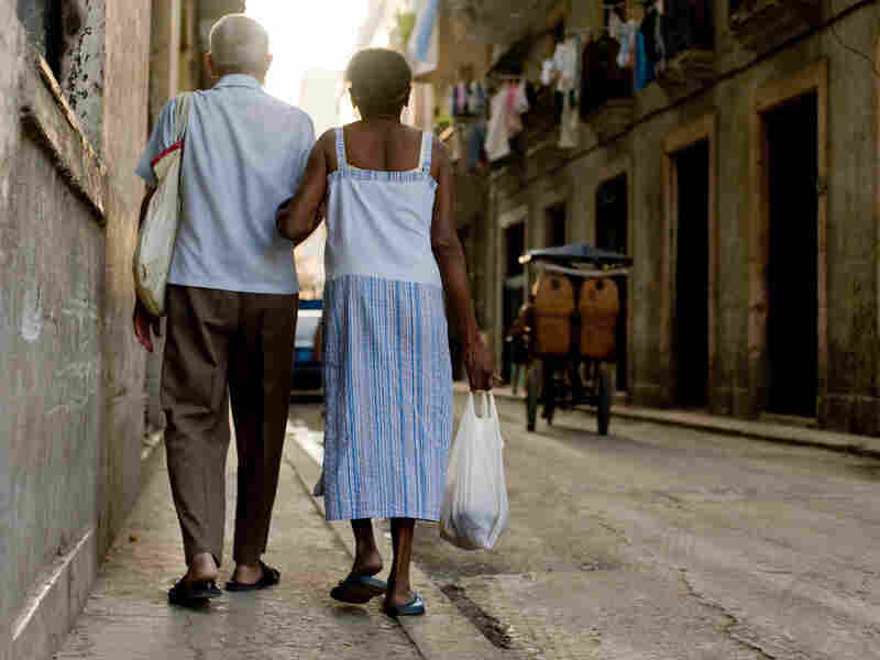 A Cuban couple returns home from a governmental food store in Havana on Wednesday.