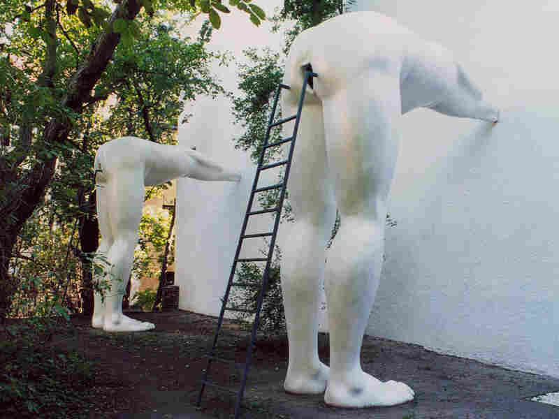 'Brownnosers' a sculpture by Czech artist and provocateur David Cerny