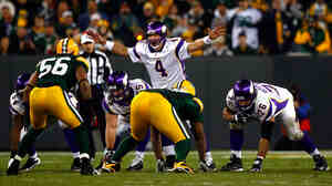 Favre calls out a play during a Nov. 1 Minnesota victory over his old Green Bay team.