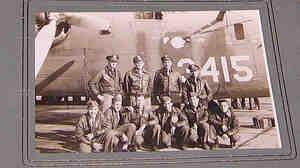 World War II veteran, flight engineer and B-24 ball turret gunner Walter Kush displays a photograph
